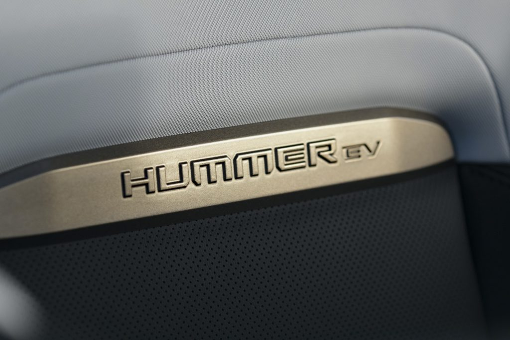 2022 GMC Hummer EV Pickup - Edition 1 - Interior 015 - Hummer EV logo on front seat