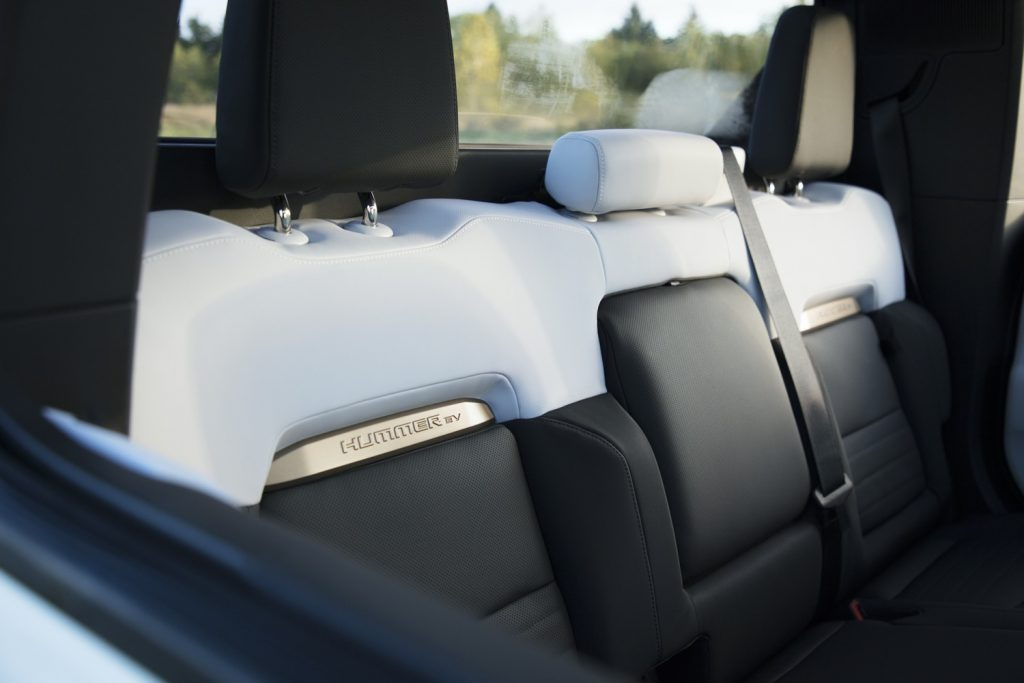 2022 GMC Hummer EV Pickup - Edition 1 - Interior 019 - rear seat backs - Hummer EV logo
