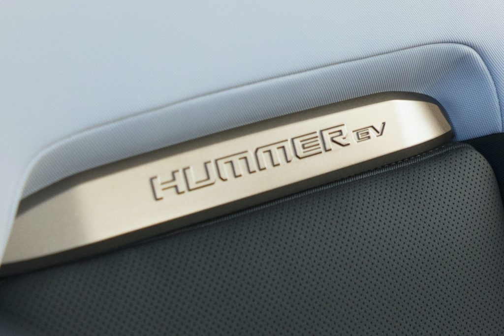 2022 GMC Hummer EV Pickup - Edition 1 - Interior 021 - rear seat backs - Hummer EV logo