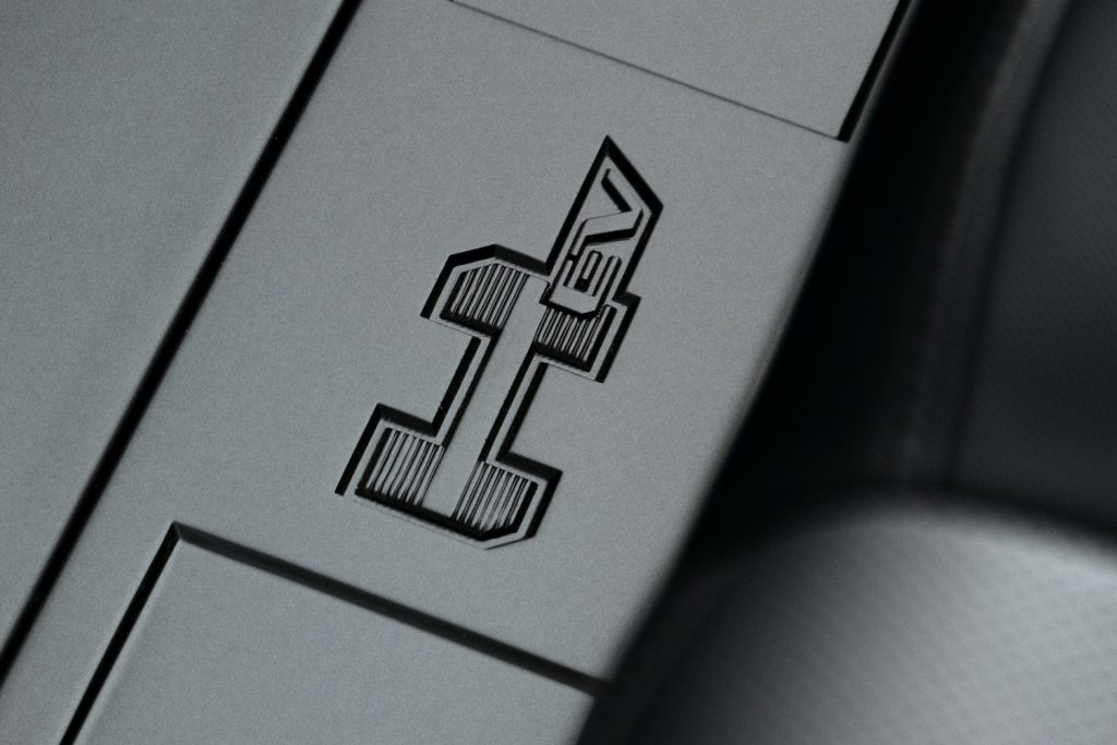 2022 GMC Hummer EV Pickup - Edition 1 - Interior 024 - HEV script logo on rear floor