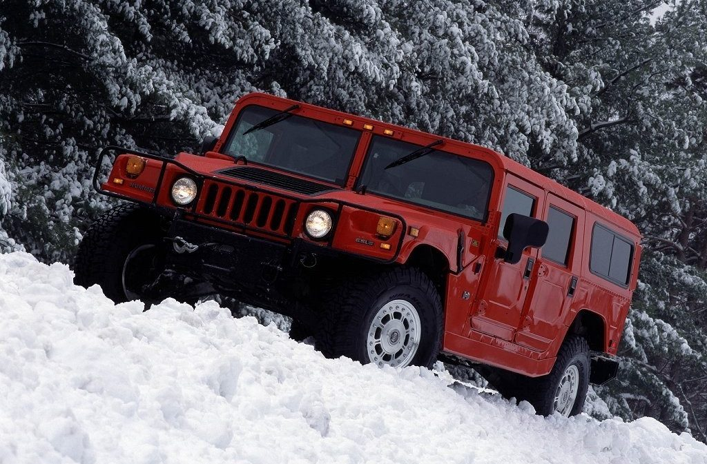 Hummer H1 - Wagon - Exterior - Snow - Front three quarters - Red